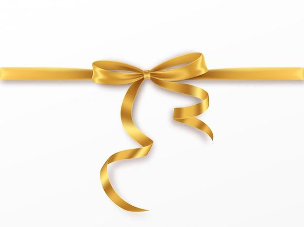 Arco e nastro dorati su fondo bianco. realistico fiocco d'oro.