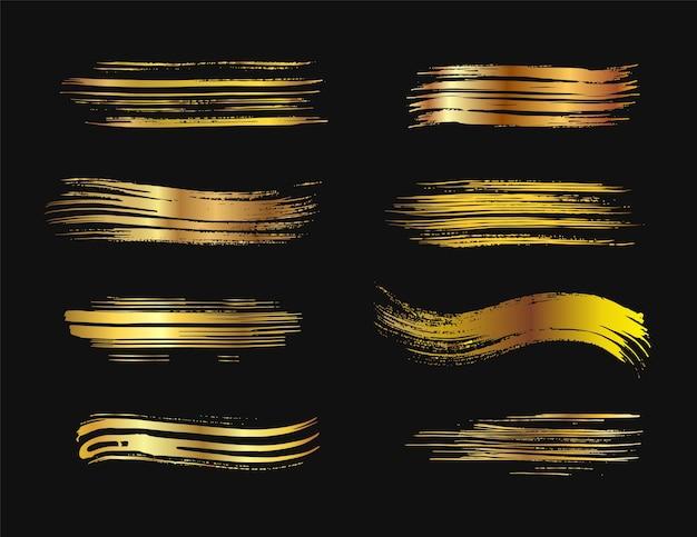 Set di pennelli dorati con sfondo nero