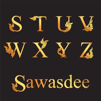 Lettera elegante dorata s, t, u, v, w, x, y, z con elementi di arte thailandese.