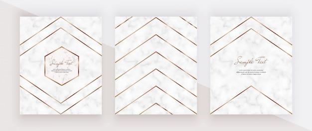 Linee poligonali geometriche dorate sulla trama in marmo.
