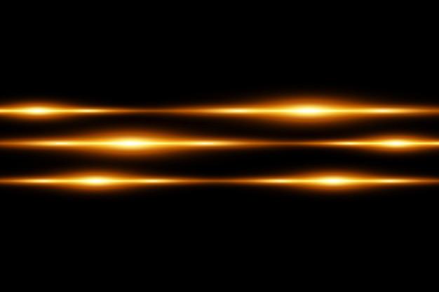 Confezione di brillamenti di lenti orizzontali dorate. raggi laser, raggi di luce orizzontali. bellissimi bagliori di luce. striature luminose su sfondo scuro. priorità bassa allineata scintillante astratta luminosa.