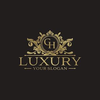 Modello di lusso dorato logo design vettoriale