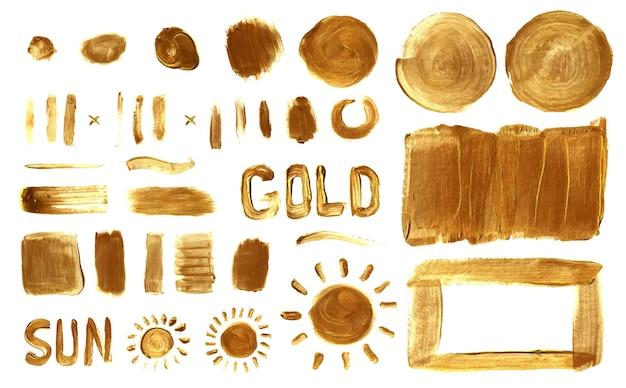 Set di pennellate di vernice dorata e forme d'oro disegnate a mano e set di vettori di sfondi