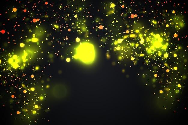 Particelle d'oro. il bokeh giallo incandescente circonda il fondo di lusso dell'oro astratto
