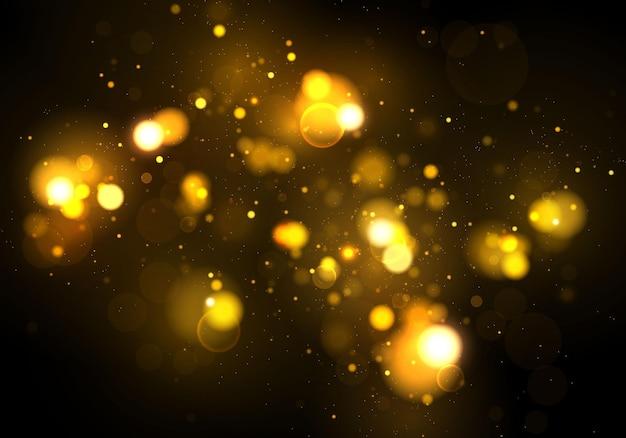 Particelle di polvere magiche scintillanti d'oro. effetto bokeh.