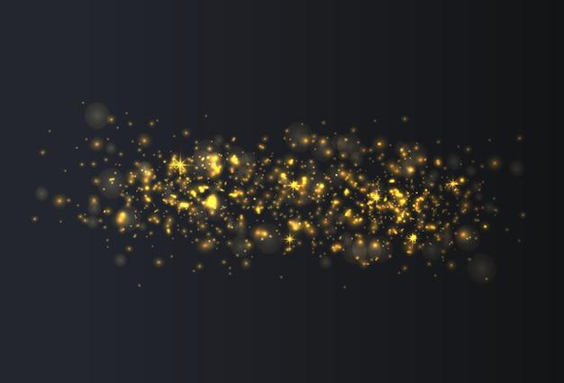 Le stelle dorate brillano di luce speciale particelle di polvere magica scintillanti