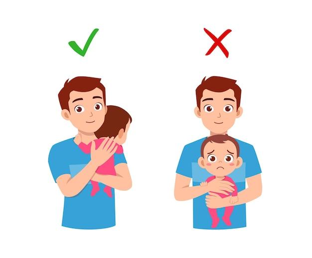 Buono e cattivo modo per il padre di tenere in braccio il bambino