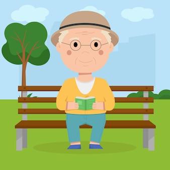 Il nonno si siede su una panchina nel parco e legge un libro.