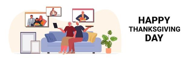 Nonni che discutono con i bambini durante la videochiamata famiglia che celebra il concetto felice giorno del ringraziamento