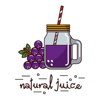 Uva e succo di frutta e vetro naturale e paglia