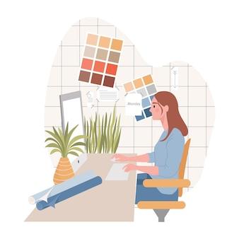 Grafico o interior designer che lavora al computer in studio di design