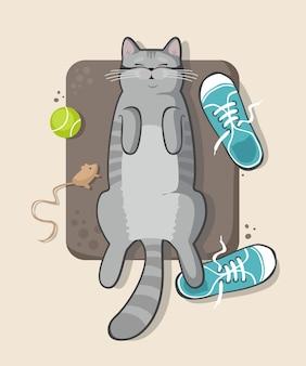 Gatto grigio che dorme sul pavimento con le scarpe da ginnastica