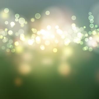 Il bokeh verde illumina la priorità bassa