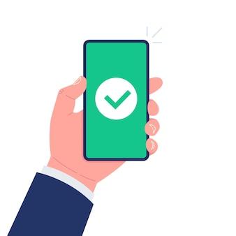 Icona del segno di spunta verde sullo schermo dello smartphone