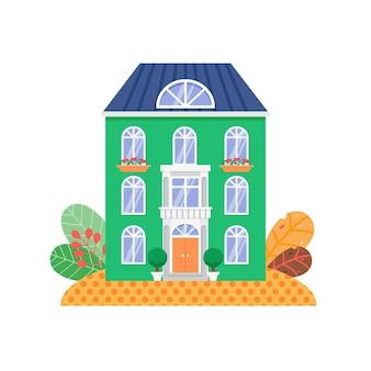 Vista frontale del cottage verde con finestre dai colori vivaci e balcone bianco con tetto blu