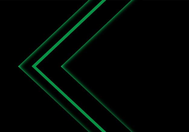 Direzione della freccia al neon della luce verde sul fondo nero dello spazio.