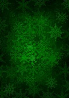 Sfondo di fiocchi di neve verde su sfondo verde scuro