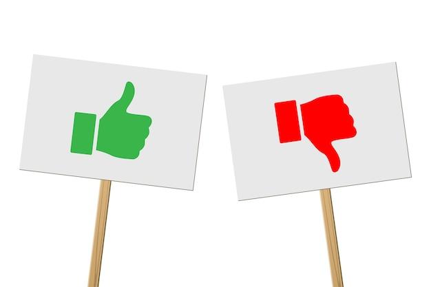 Pollice in su verde e pollice in giù rosso su striscioni su bastoni di legno, segni di protesta su sfondo bianco.