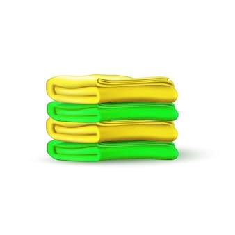 Mockup di asciugamano giallo verde mucchio di stoffa di cotone piegato in tessuto per bagno