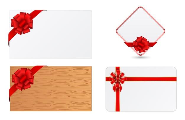 Saluto carta regalo in bianco con fiocco rosso e nastro