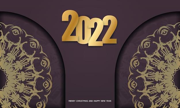 Modello di biglietto di auguri 2022 buon natale colore bordeaux con ornamenti d'oro di lusso