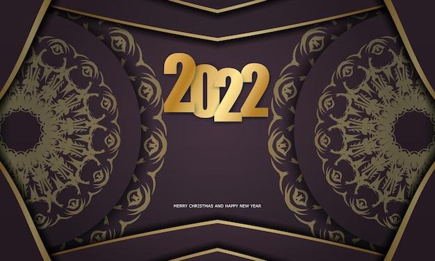 Modello di biglietto di auguri 2022 buon natale e felice anno nuovo color bordeaux con ornamenti d'oro di lusso