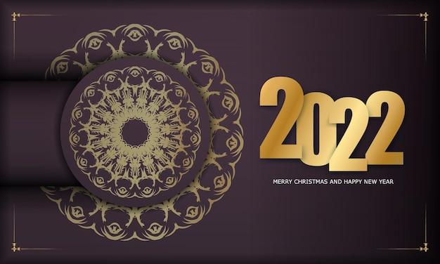 Modello di biglietto di auguri 2022 buon natale e felice anno nuovo color bordeaux con ornamenti d'oro vintage