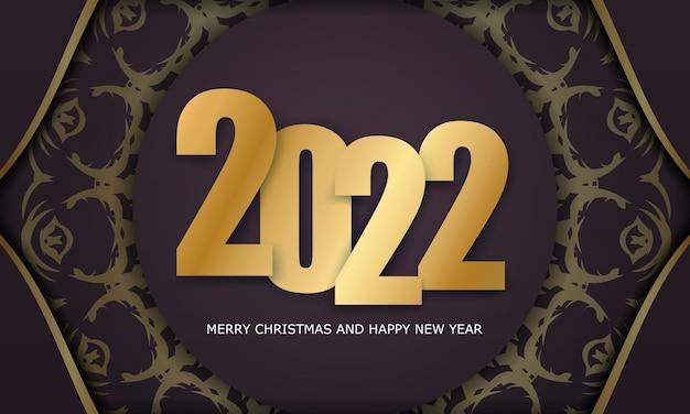 Modello di biglietto di auguri 2022 buon natale e felice anno nuovo colore bordeaux con motivo oro vintage