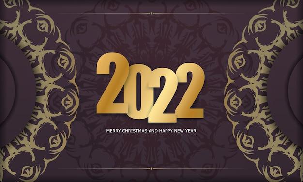 Modello di biglietto di auguri 2022 buon natale e felice anno nuovo color bordeaux con ornamento d'oro invernale