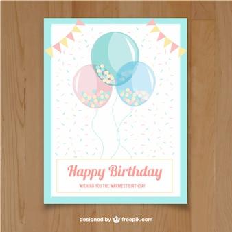 Biglietto di auguri con palloncini e ghirlande in colori pastello