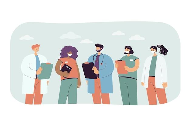 Gruppo di medici e infermieri dei cartoni animati in uniforme. illustrazione piatta