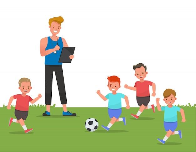 Gruppo di bambini che giocano a calcio con il personaggio di allenatore.