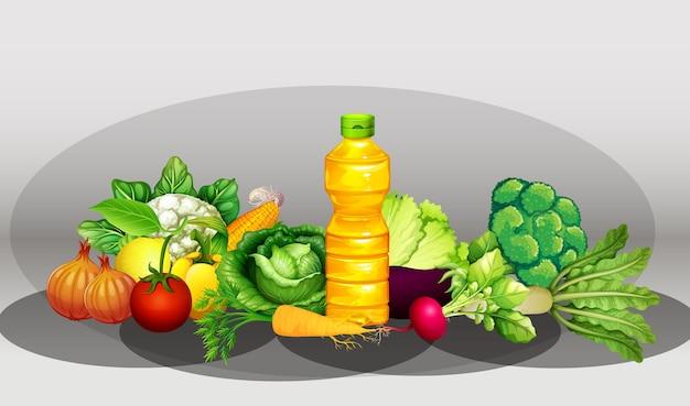 Gruppo di diverse verdure e bottiglia di olio