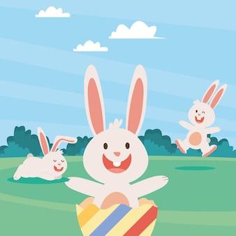 Gruppo di conigli pasquali e uova dipinte nell'illustrazione dei personaggi del campo