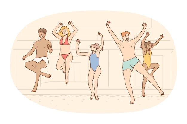 Gruppo di amici che saltano nell'acqua della piscina