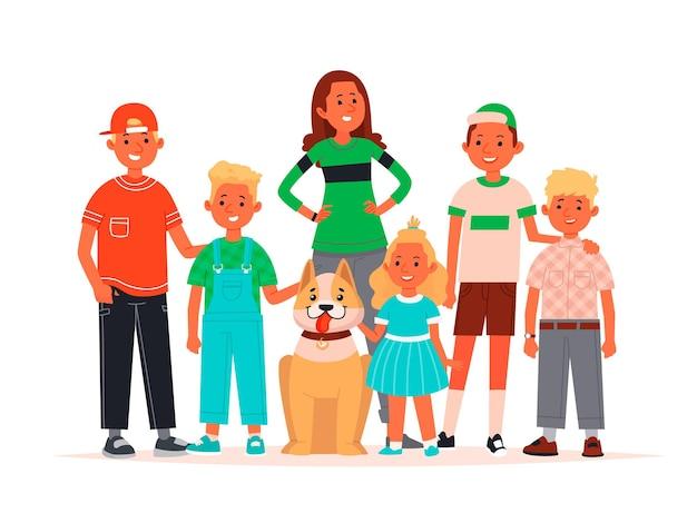 Un gruppo di bambini felici di età diverse sono in piedi insieme a un cane su bianco