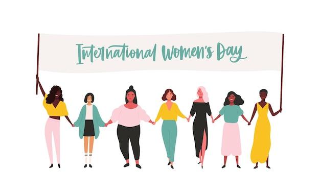 Gruppo di giovani ragazze felici o attivisti del femminismo che prendono parte al raduno o alla parata e che tengono la bandiera con l'iscrizione della giornata internazionale della donna illustrazione piatta per la celebrazione dell'8 marzo.
