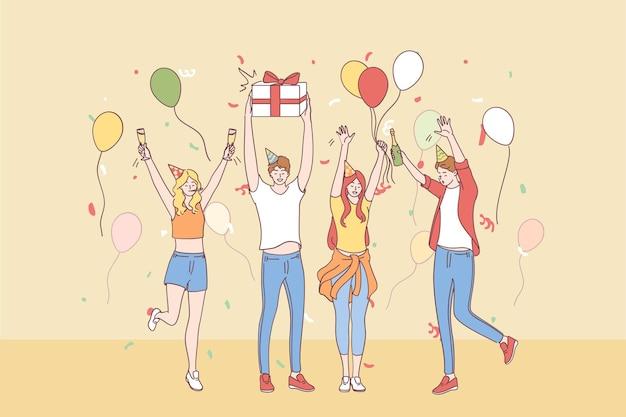 Gruppo di personaggi dei cartoni animati di amici giovani felici in cappelli festivi alzando le mani per celebrare insieme la festa con coriandoli, champagne e scatole presenti