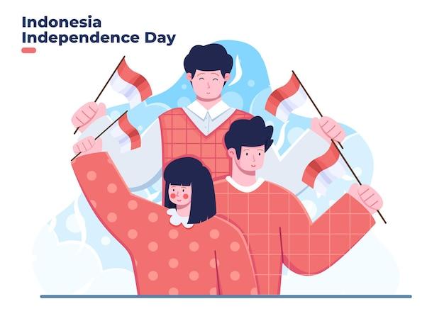 Un gruppo di persone celebra il giorno dell'indipendenza dell'indonesia il 17 agosto tenendo in mano la bandiera nazionale dell'indonesia