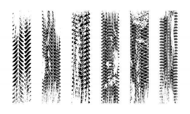 Tracce di pneumatici grunge texture. collezione modello di pneumatici senza soluzione di continuità. immagine dettagliata della protezione delle tracce.