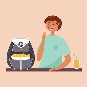 Il ragazzo mangia patatine fritte con la friggitrice ad aria