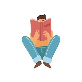 Ragazzo seduto su un pavimento e leggendo un libro isolato su sfondo bianco vista frontale amante del libro