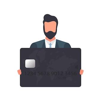 Il ragazzo con gli occhiali ha in mano una carta bancaria nera. giovane maschio in possesso di carta di plastica per bancomat isolato su sfondo bianco. vettore.