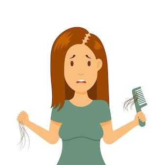 Perdita di capelli nel problema femminile. la ragazza tiene in mano un pettine. alopecia nella donna, calvizie in giovane età