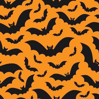 Reticolo di halloween con i pipistrelli reticolo senza giunte di vettore con i pipistrelli neri su sfondo arancione