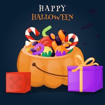 Cesto di zucca di halloween pieno di caramelle e dolci.