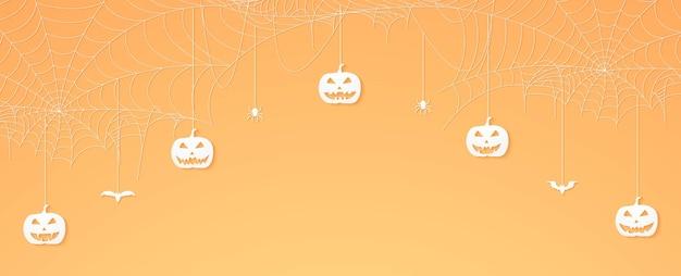 Testa di zucca di halloween, ragni e pipistrelli appesi, banner di ragnatela, sfondo di ragnatela, spazio di copia
