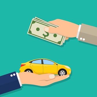 Mano dell'uomo d'affari con soldi che acquistano un'automobile