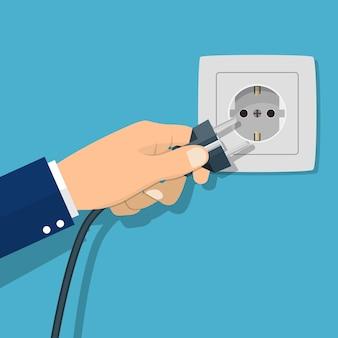 Mano che collega la spina elettrica. illustrazione vettoriale in design piatto