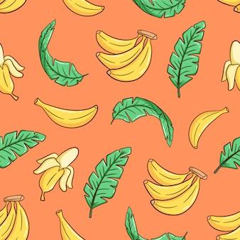Banana disegnata a mano e foglie di banano senza cuciture Vettore Premium